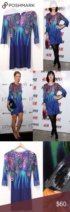 Matthew Williamson For H&M Peacock Dress  So so so super cute! NWOT this dress has only been tried on. So much COLOR and personality in this mini! We know EXACTLY why countless celebs chose to rock this piece. IT'S GORGEOUS!!! Matthew Williamson for H&M signature PEACOCK DRESS size Blue/purple/green/pink with sequinned cuffs. 100% viscose Happy Poshing ladies   Same/Next Day Shipping  Odor Free  Pet Free  PayPal/Trade H&M Dresses Mini