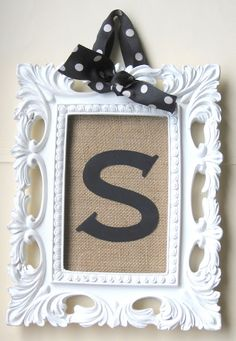 Like this look, maybe using a flat wood letter instead. Very Cute wall decor, or even placed standing in an easel.