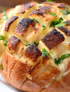 Pull apart garlic bread with cheese.