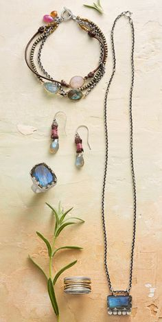 Modern Amulet Necklace, Count of Three Bracelet, Ranch Rose Earrings, Love of Labradorite Ring, Fond Embrace Ring. All found at Sundance. The URL given is for the necklace.