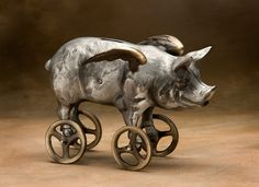 Flying Pig Coin Bank, Cast Aluminum with Bronze Wheels. $175.00, via Etsy.