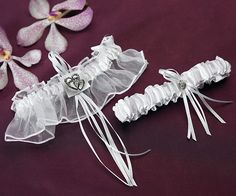 Two Piece Classic Double Heart Wedding Garter Set. I think this is so cute.