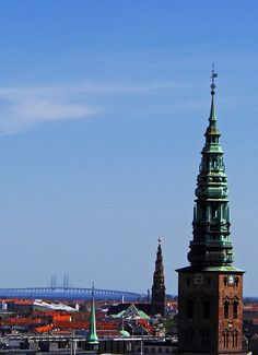 The towers in the city centre and the Oeresundsbron - the bridge that connects Copenhagen with Malmö, Sweden (Copenhagen, København, CPH, KBH, Danmark, Danish, Denmark, travel, Europe, city, capital, visit, beautiful)