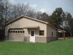 Pole barn garage with ManCave in the back. Double garage doors though with no window up front.