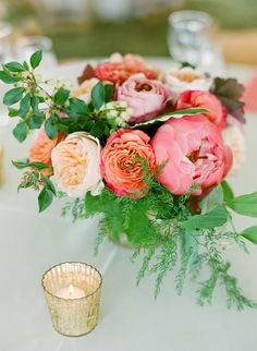 full pink + peach floral centerpiece // photo by Stacey Hedman, floral design by Petal Floral Design // View more: http://ruffledblog.com/romantic-marthas-vineyard-wedding/