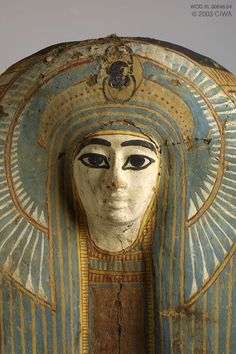 """Sarcophagus of a queen. This upper part of a sarcophagus displays the portrait of a young queen of the New Kingdom, Dynasty 18. A magnificent Inpw (Anubis as a jackal), """"he who is over the secrets,"""" rests upon a column of secret words.  Sadly, we will never know her identity and, according to Egyptian beliefs, unless someone pronounces her name, she loses the eternal life she hoped for."""