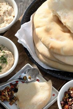Golden Pita Bread Recipe. Baked on pizza stone at 500 degrees for 2-3 minutes.