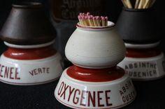 "Three different vintage ""pyrogénes"" (matchstrikers) advertising Absinthe Cusenier"