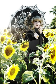 Beautiful Gothic lolita shoot.   I want a picture in a field full of flowers as well :(