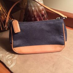 Coach purse REDUCED Small Coach purse.   Dark blue denim with tan leather trim.  One pocket inside.  Gently used. Coach Bags Mini Bags