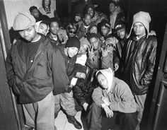 Wu-Tang Clan and a few friends from the neighborhood pose for a portrait Shaolin New York City in 1993.  Photography by @chimodu. by hiphopphotomuseum