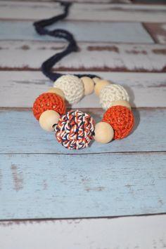 Love navy, orange, and khaki!  #crochetbeadnecklace #teeethingnecklace #nursingnecklace #teething #ecofriendlybaby #ecofriendlybabytoy #teethingring