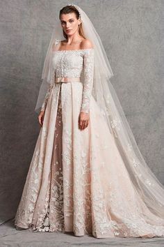Discover the most beautiful wedding dresses from the collection of wedding dresses. the perfect wedding dress is easy to find with these models. Unique, elegant and beautiful wedding dresses. Find Your Dream wedding dress. Wedding Dress Sleeves, Long Sleeve Wedding, Modest Wedding Dresses, Boho Wedding Dress, Wedding Attire, Bridal Dresses, Ivory Dresses, Wedding Bouquets, Bridesmaid Dresses