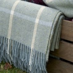 Keep yourself cosy at night on the beach or if the wind picks up with our gorgeously nautical duck egg ivory check shetland wool throw