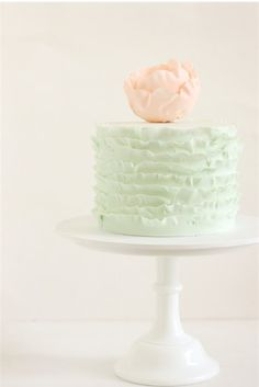 hello naomi mint green ruffled cake with pink flower