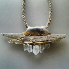by Adina Mills. Driftwood, molten gold & raw crystal.