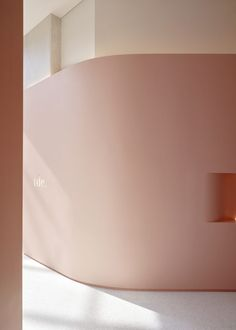 Lately, Pattern Studio designed the concept of the latest flagship of The Daily Edited in Melbourne   Lily Goodwin and Josh cain   Australian interior design   Australian designers   Melbourne new store   2018 new store   pink architecture   pink walls   pink interior design   pink marble   white terrazzo   luxurious flagship   luxury architecture   led lighting   Parachilna lighting   curvy interior   curvy walls   futuristic interior   minimalist store   minimal interior design...