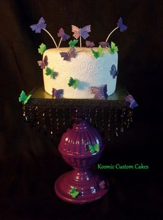 Purple & Green Butterfly Cake For more pics - Find us on Facebook TODAY! Kosmic Custom Cakes