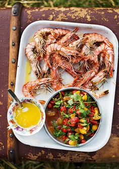 This griddled prawns recipe can be made on the barbecue or in a griddle pan. They are accompanied with a colourful summery salsa.