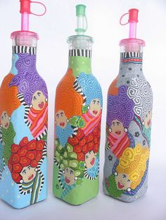 olive oil dispensers. so fun and colorful. This could be done using a clear glass wine bottle & covering in colored translucent clays, then adding white christmas lights to the inside.