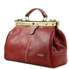 Tuscany LeatherItalian leather goodsBrand: Tuscany LeatherName: Michelangelo - Doctors - Gladstone / Handbag - With Shoulder StrapColours Available: Brown, Dark Brown, Black, Red, HoneyProduct Code: TL 10038Dimensions: Wx33cmx23.5cmx15cm - Packaged Weight 1.2KgMaterial External: Polished Calf - Skin LeatherHardware: Antique Brass (Goldtone)Material Internal: Cotton LiningExterior Features: Rigid Leather Grab Handle, Secure Zipped Pocket To RearInternal Features: 2 Compartments, Internal ...