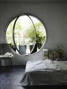 Clever rotating round window allows the breeze to be directed around the room