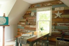 cute use of reclaimed wood, and good idea to use a through the wall A/C unit to make use of an attic space that doesn't need climate control all the time