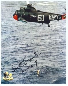 Autographed photo of Scott Carpenter being hoisted aboard Sikorsky HSS-2 (SH-3A) Sea King, Bu. No. 148964 (c/n 61-036), in the Atlantic Ocean, 24 May 1962. (U.S. Navy)