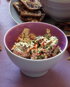 Capers and anchovies lend a briny flavor that complements meaty tuna in this easy appetizer that's best served with vegetable chips.