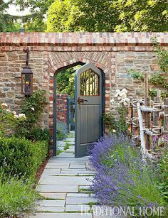 Restored Tudor House in Utah The kitchen garden is accented by a new stone-and-brick wall and a stone path. - Photo: Emily Minton RedfieldThe kitchen garden is accented by a new stone-and-brick wall and a stone path. Brick Wall Gardens, Brick Garden, Brick Fence, Brick Courtyard, Wooden Garden, Garden Doors, Garden Gates, Secret Garden Door, Patio Wall