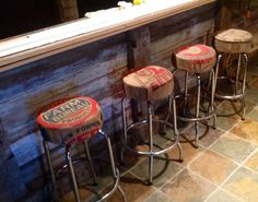 I used antique burlap feed sacks to recover my boyfriend's bar stools.