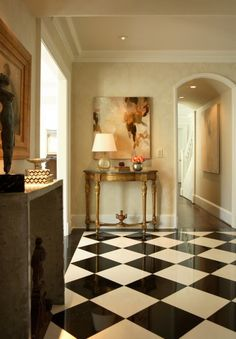 elegant-dramatic-flooring-tile-black-white-diamond-pattern-foyer- Carefully chosen and placed novelty tables and furniture add charm and cosiness. hall-entry-way-decorating--abstract-art-console-table-decor-Dillard-Design-Group Design Hall, Design Entrée, Floor Design, House Design, Design Ideas, Design Inspiration, Home Interior, Interior Design, Interior Decorating