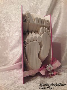 These baby feet with the name Anna were a special order for the christening of the godchild. The cover in the color pink was not easy to find, a real challenge. Book Crafts, Diy And Crafts, Paper Crafts, Recycled Books, Recycled Crafts, Short Birthday Wishes, Baby Name Book, Altered Book Art, Book Folding Patterns