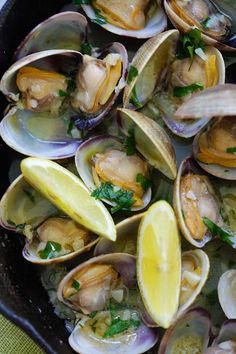 Sauteed Clams - Skillet clams with loads of garlic butter, white wine and parsley. The easiest sauteed clams recipe ever, 15 mins to make.