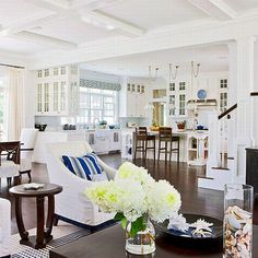 Open concept kitchen, ceiling detail, white cabinets, moulding
