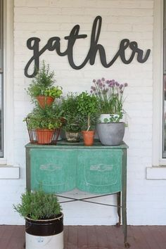 Love the pop of color and collection of potted plants.could do without the random verb on the wall.