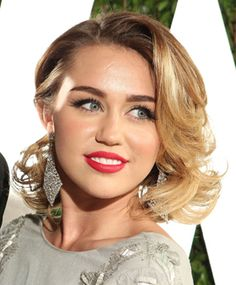 Hairstyle Ideas to Consider: Try a side part. Pair the side part with red lips for Miley Cyrus' look.