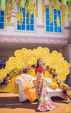 Bridal portrait on mehendi day with kitsch mehendi outfit with a high low skirt and full of colour Indian Wedding Planning, Wedding Planning Websites, Mehendi Outfits, Bridal Outfits, Bridal Dresses, Wedding Story, Plan Your Wedding, Bridal Lehenga Collection, Wedding Dress Accessories