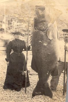 Mrs. A.W. (Pauline) Barrett and boatman Jim Gardner with the black sea bass she had caught, 1901