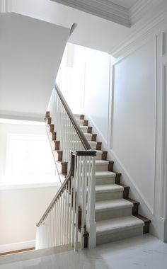 Staircase designed by Enviable Designs - Clean white stairwell accent with dark . Staircase designed by Enviable Designs - Clean white stairwell accent with dark stained wood. Additionally adding of Staircase Interior Design, Staircase Wall Decor, White Staircase, Wood Staircase, Staircase Makeover, Railing Design, Residential Interior Design, Stair Railing, Banisters