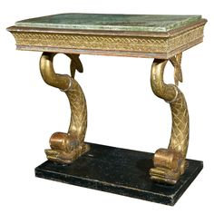 Swedish console table, c. 1800-1810  Sweden  early 19th century  Swedish console table, c. 1800-1810, in original gilded and polychrome finish with carved dolphin supports below a faux porphory top, Empire period.