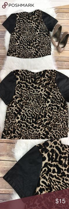 Animal print blouse w/faux leather sleeves exposed zipper at the back. side vents. polyester. H&M Tops Blouses