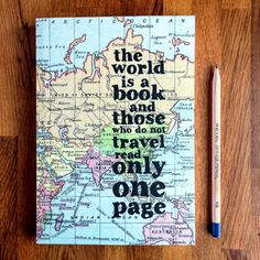 A beautiful travel journal covered in a vintage world map and a quote to inspire exploration.  ''The world is a book and those who do not travel read