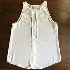White sleeveless blouse White Sleeveless Blouse with a v-neck opening . Wore this once. Great condition. Monteau Tops Blouses