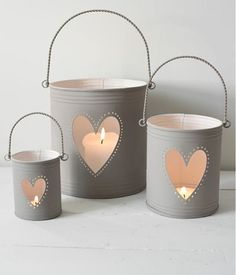 View our candle lanterns and hurricane lamps including wooden hurricanes, garden lanterns, large lanterns, glass lanterns, metal lanterns and metal candle holdersHeart candle Holders - possibly diy? Glass Candlestick Holders, Glass Candlesticks, Candle Holders, Indoor Candle Lanterns, Hurricane Lanterns, Porch Lanterns, Table Lanterns, Candle Lighting, Tin Can Crafts