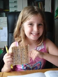 Make an ancient Chinese book with popsicle sticks and rafia.  AND my kids actually know how to write Chinese characters!  This would be great as a keepsake!