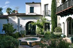Balconies of wrought iron and turned wood overlook a star-shaped fountain   archdigest.com