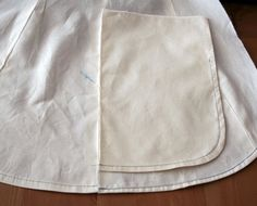 It's often quite tricky to hem anything curved or round depending on severity of the curve and type of fabric. Here are two tricks to make it a bit easier. The first works well for those slight curves and the second may be better for the more severe ones. forum