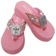 63c70a8f2  Overstock - Sparkling rhinestones highlight these stylish pink flip-flops  from Hidden Soles.