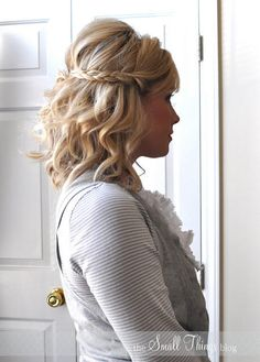 This braided look is sure to put a spring in your step. Curl your hair with a ¾-inch barrel for an allover beachy wave. Next, braid two sections from the front, pull both back, and pin. Hint: Apply pomade to the ends of your curls by separating and gently tugging down for a piece-y, mussed-up texture.